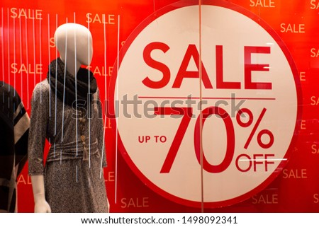 70% off sales promotion on retail shop display window. Black Friday, Clearance, Mega sale