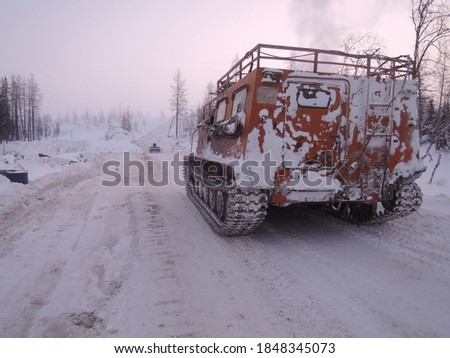 Offroader on a winter road in the Arctic, in a frosty fog          Stock photo ©