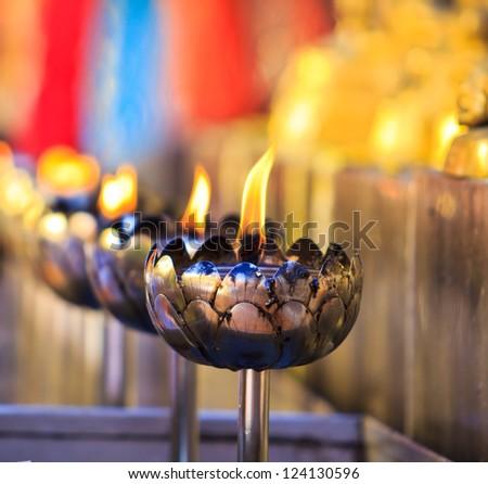 oil lamp arranged in patterns - stock photo