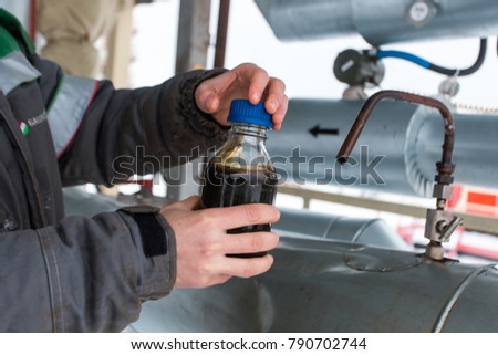 Oil sample. The process of sampling oil.