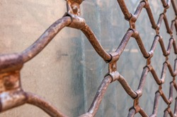 Old and rusty metal fence. Vintage
