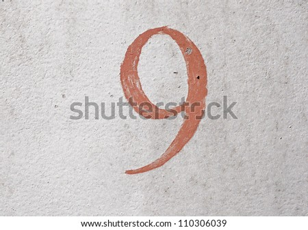 9 - old brown handwritten digit over grunge silver background