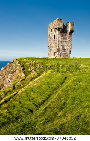 Old castle on Cliffs of Moher in Ireland.