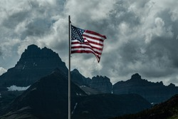 2709 Old Glory, the American Flag, stands out against a stormy sky over Swiftcurrent Lake at Glacier National Park - Montana