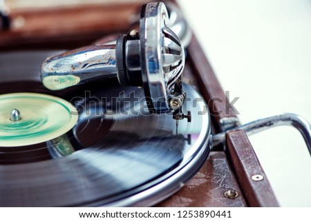 old gramophone on white background #1253890441