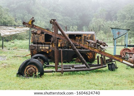 Old machinery in nature is broken, repaired
