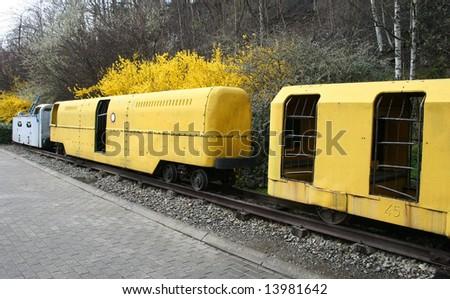 old mine Belgium, coal wagons on railway tracks- museum - stock photo