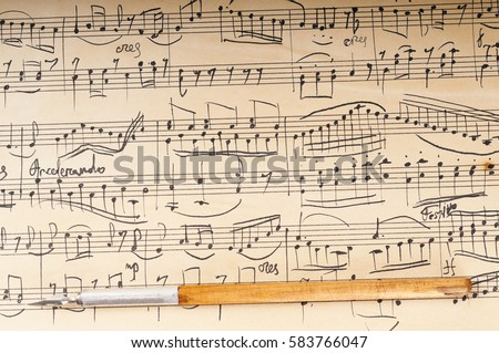 Old music sheet. Manuscript. Ancient writing pen #583766047