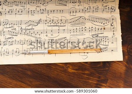 Old music sheet. Manuscript. Ancient writing pen #589301060