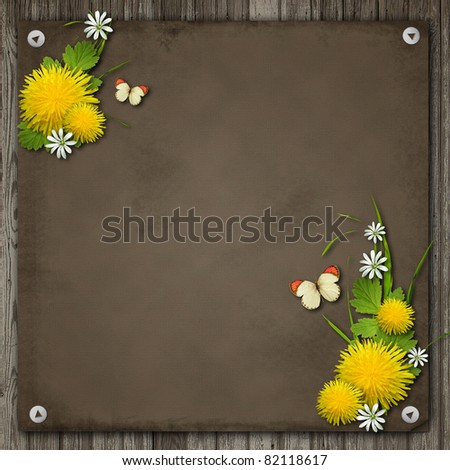 Old paper and dandelion over an old wood background