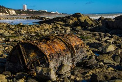 Old rusty barrel on the seven sisters beach in England