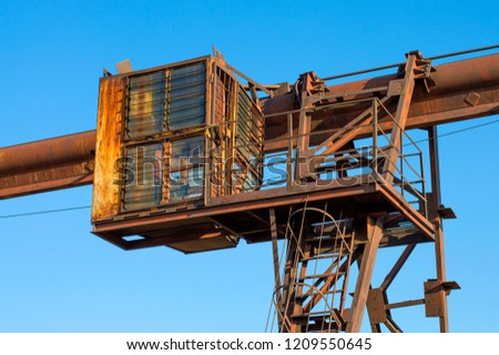 Old rusty gantry crane on an abandoned enterprise