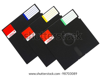 3 old school floppy disks, isolated on white background.