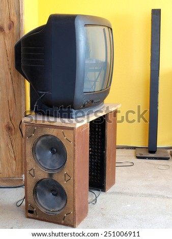 Old TV  set on homemade table from speakers in wood boxes