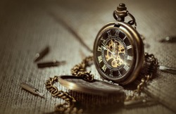 old, vintage pocket watch on a chain
