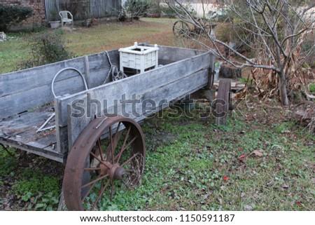 Old Wagon In A Flower Garden #1150591187