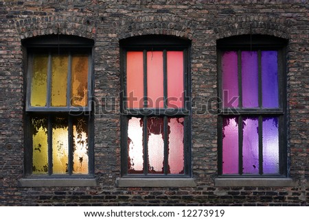 3 old weathered windows with backlight during sunset