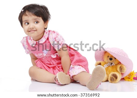 2-3 old year baby girl securing teddy bear