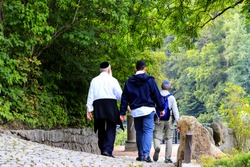 Older people, a Hasidic Jews family  walk in the Sofia park during the Jewish New Year. Uman, Ukraine, follower of Judaism