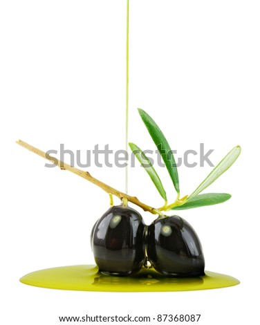 Olives under an olive oil stream isolated on white