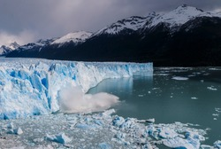 Сollapse of Perito Moreno Glacier in the lake with icebergs. South America. Argentina. Patagonia.