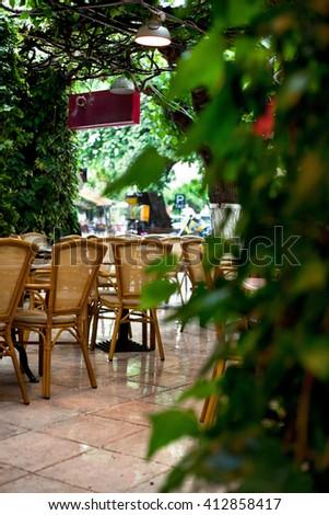 'Olympia. Cafe. Rain' - Shutterstock ID 412858417