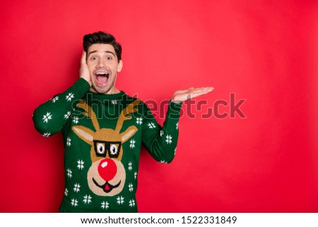 2020 omg! Miracle! Portrait of excited funky funny crazy man scream wow wonder about christmas shopping sales wear deer reindeer jumper isolated over red color background