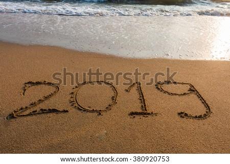 2019  on a beach sand background #380920753