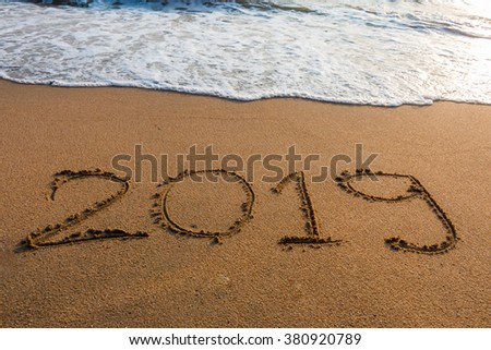 2019  on a beach sand background #380920789