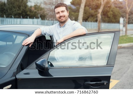 One man holding a car key next to his vehicle