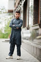 Сonfident pakistani indian muslim arabic boy in grey kameez shalwar suit.