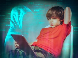 online safety concept   young boy surfing the web  and hooded hacker