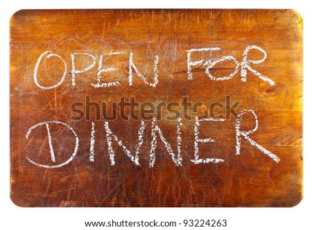 """Open for dinner"" text on wooden cutting board isolated on white background"