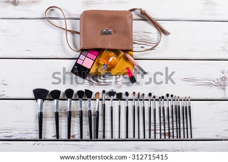 Open ladies handbag with scattered accessories. Fashion women\'s handbag.