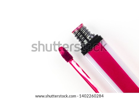 80860bd07ef Open lipstick with a brush for applying and smear in red on a white  background.