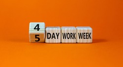 4 or 5 day work week symbol. Turned the cube and changed words '5 day work week' to '4 day work week'. Beautiful orange background. Copy space. Business and 4 or 5 day work week concept.