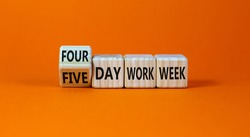 4 or 5 day work week symbol. Turned the cube and changed words 'five day work week' to 'four day work week'. Beautiful orange background. Copy space. Business and 4 or 5 day work week concept.