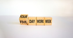 4 or 5 day work week symbol. Turned the cube and changed words 'five day work week' to 'four day work week'. Beautiful white background. Copy space. Business and 4 or 5 day work week concept.