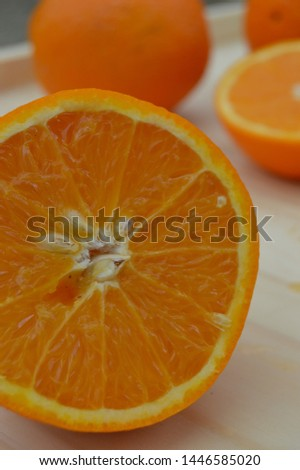 Orange, half an orange, an orange peal and a basket with oranges on a white table #1446585020