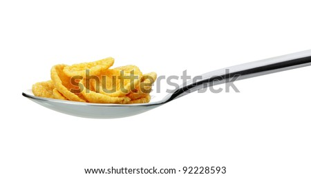 ?ornflakes. A dry breakfast in a spoon. It is isolated on a white background