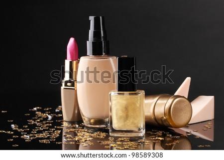 ?osmetics isolated on black