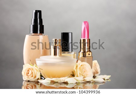 ?osmetics with roses on gray