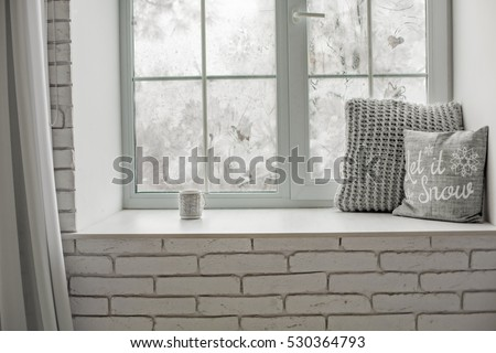 ?ozy and frost winter still life:  hot tea or coffee  warm woolen knitting decoration on windowsill against snow landscape from outside. - Shutterstock ID 530364793