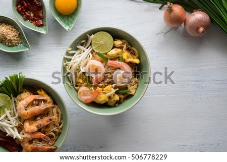 """""""Pad Thai"""",pad thai is a Rice noodles with shrimps and ingredients spices pad thai on the table. top view of a horizontal, local food pad thai in thailand. #506778229"""