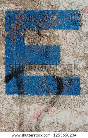 painted letter on wall, letter e #1253650234