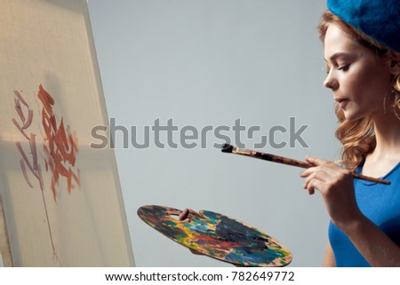 painter draws on canvas holds a palette on a gray background, paint, drawing, draw                              #782649772