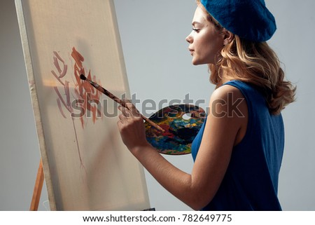 painter draws on canvas holds a palette on a gray background, paint, drawing, draw                              #782649775