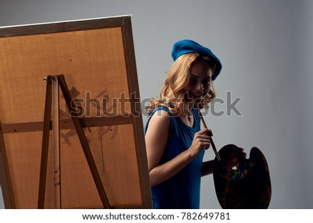 painter draws on canvas holds a palette on a gray background, paint, drawing, draw                              #782649781