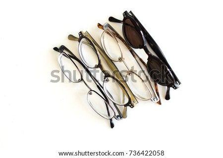 3 pairs of stylish eyeglasses and 1 pair of sunglasses in a row isolated on white #736422058