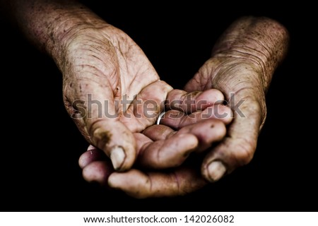 palms of  old man on a black background.